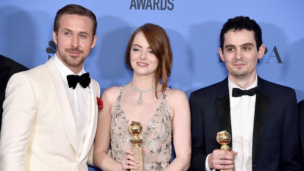 """Ryan Gosling, Emma Stone e Damien Chazelle, felici vincitori del Golden per """"La la land"""""""